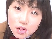 Reika Midoh face covered in sperm while she rubs it in