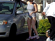 Hot chick loses top in parking lot!