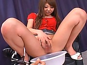 Ana Oshirino spreads her legs and plays with her wet pussy