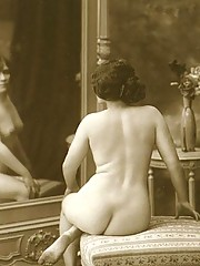 Vintage girls standing in front of mirrors