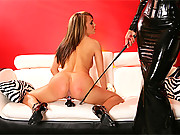 Misstress slapping her tight butt with whip