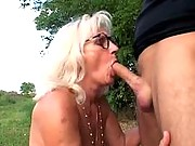 Younger dude fingers granny pussy