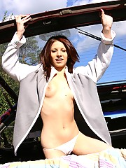 Adorable cutie undressing in the car trunk