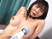 Maria Yuki pussy and nipples stimulated by a large vibrator