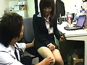 Japanese AV Model lifts her skirt and shows her hairy pussy
