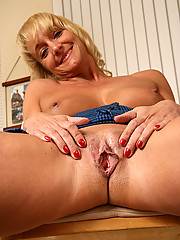 Blonde and mature 44 year old Barbie playing with her seasoned puss