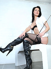 British booted brunette dominatrix