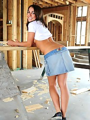 Taylor Lain plays at an construction site in a short skirt