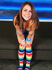 Taylor Lain wears rainbow tube socks and a short skirt while masturbating to her rabbit dildo
