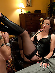 Mistress Bobbi Starr locks her cuckold slave in chastity while he