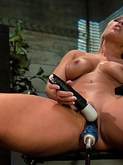 Lesbian MILF mall cop fucks mall rat with machines. The girl cums and squirts while the blond MILF fucks her.