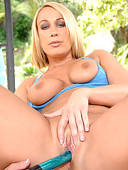 Horny Mellanie Monroe loves to workout on her gym ball with a vibrator working her mature pussy