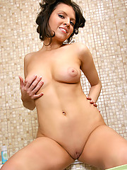 Naughty Jereni gets her nude body in the bathtub and sprays her tits and pussy with the shower head
