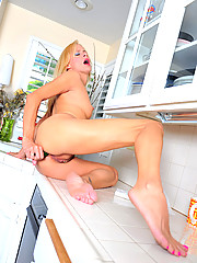 Classy soccer mom Payton Leigh stuffs a cucumber in her pussy and then her ass