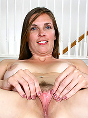 Long haired milf Laila gets naked and spreads her legs displaying her pussy on a trampoline