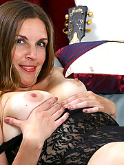 Laila flaunts her mature tits and spreads her legs wide open on the couch