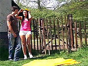 A daring teenage couple is fucking outdoors