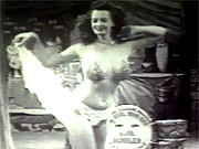 The sexy Betty Howard enjoys dancing topless
