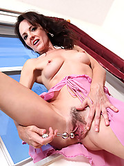 Horny Anilos cougar in sheer pink lingerie bangs her mature fuck hole with her favorite sex toy