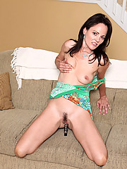 Tempting cougar Danielle Reage loves to hang out on her sofa with a vibrator drilling her pierced pussy