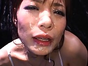 Nao Mizuki rubs her hairy pussy with vibrator and shows tits