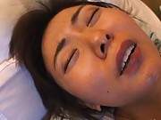 Maria Yuki grabs her tits as she bounces on his cock during sex