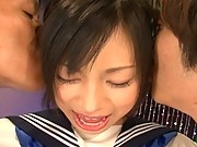 Shoko Mimura in her schoolgirl uniform with two guys