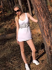Naked teenage chick masturbating in the woods