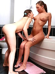 Two very horny lesbian babes taking a bath