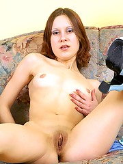 Sweetie exposing her damp vagina on the couch