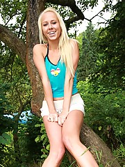 Blonde masturbating in a big tree with a toy