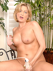 Sexy Lya Pink shows off her perky ass and satisfies her cravings for sex with a magic wand