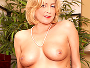Classy cougar Lya Pink plays with her greedy pussy