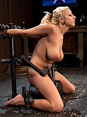 Big-tit blond Lylith Lavey bound in seated metal strappado on Sybian.