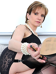 Milf in black corselette and nylons