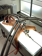 Brand new hottie strapped down in a sci-fi lab with cold metal machines working her hot pussy and ass, suction on her nipples, clamp gag in her mouth.