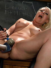 Blond babe takes big mechanical dick in her ass and pussy, squirts on the thick dick and screams while cumming.
