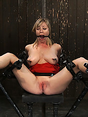 Incredibly hot Adrianna Nicole legs spread wide in metal bondage, helpless and drooling on her big natural tits.