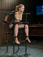 Hot blonde, bound in a custom metal bondage rig.  Made to cum over and over, her wet shaved pussy can