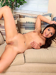 Beautiful babe Aj Estrada shows off her luscious tits and pussy on the couch