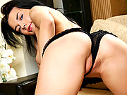 Nubile Liolya massages her big tits and sweet pussy