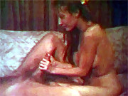 A retro chick is sucking and giving a handjob
