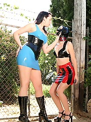 Massaging her damp latex wearing slave pussy