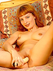Cute chick playing with large plastic wiener