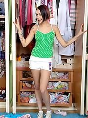 Naked cutie playing in a closet with herself