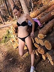 Sexy teenager undressing naked in the woods