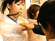 Japanese AV Model has bubble wrap around her in this video