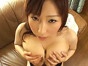 Ai Sayama giving a blowjob while playing with her big boobs