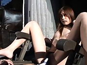 Chiaki sits on a patio chair and masturbates outdoors