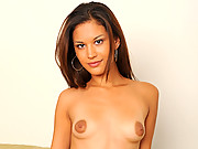 Ariana Fox takes off her bikini and masturbates on the couch
